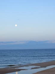 A nearly full moon over the ocean.  Photo taken by me.